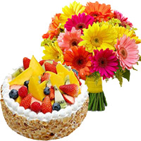 combination of 5 star hotel with 24 mix gerbera and 1 kg fruit cake
