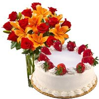 Combo of 5 star Bakery cake, 1 kg Strawberry cake with 12 roses and 8 orange lily