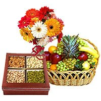 Mix dry fruit with 3 kg fruit basket and Bouquet of 12 mix gerbera