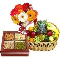 1 kg fresh fruits basket, 500 gm mix dry fruits and 12 mix gerbera - Anniversary Gifts to India