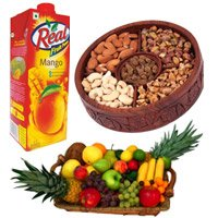 1 kg mix dry fruits, 2 kg fruit basket and 1 kg real Juice - Anniversary Gifts to India