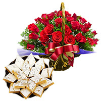 Sweets gift Basket of red roses with kaju katli