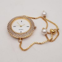 Online delivery of Ladies Fancy Watch to gift for sister to India