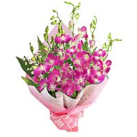 Bhai Dooj Flowers gift arrangements of 15 purple orchids bouquets to India