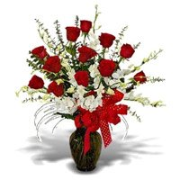 Send 5 White Orchids 12 Red Roses in Vase. Rakhi Flower Delivery in India