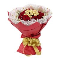 Valentine's Day Flowers to India. 16 Pcs Ferrero Rocher Chocolate encircled with 20 Red Roses and Flowers to India